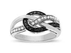 An elegant tangle of flashing metal and sparkling stones will ensnare you with its mysterious charm. Black and white diamonds totaling 1/4 ct are woven with threads of sterling silver to create this sleek ring.Ring is a size 7.