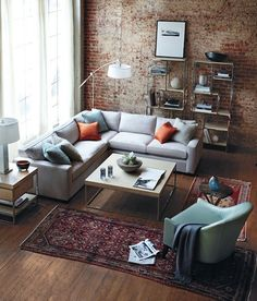 I prefer the comfort of this room, inviting and relaxing to me. My couch is and L shape so considering this type of coffee table to make it cozier