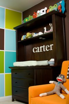 Convert an old desk or entertainment center into a changing table and paint! Love.