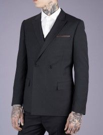 Suit and tattoos.