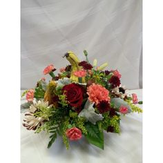 Centerpiece with gourds,fall pompons, roses, dried flowers, dusty miller.