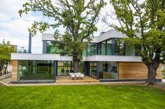 Diseño de Interiores & Arquitectura: Casa Contemporánea Integrada con árboles en su Arquitectura Moderna