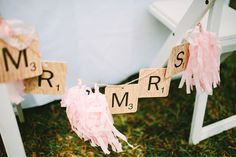 mr. + mrs. scrabble chair backs // photo by Pat Furey // View more: http://ruffledblog.com/hawaiian-island-wedding/
