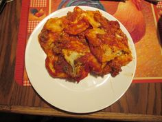 Three cheese ravioli layered with hamburger and shredded mozzarella cooked in ragu seasoned with Italian seasoning and garlic powder.
