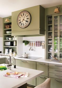 sage green and white kitchen