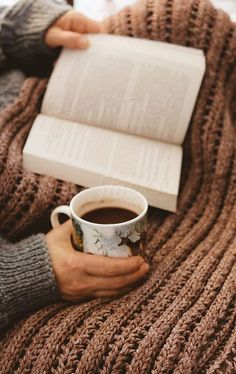 A book and a cup of cup will give me a enjoyable afternoon.
