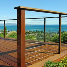 Deck railing isn't just a security feature. It can add a sensational visual to frame a decked location or deck. These 36 deck railing ideas reveal you how it's done! Cable Stair Railing, Wire Deck Railing, Deck Railing Kits, Deck Railing Design, Deck Design, Railing Ideas, Railings For Decks, Outdoor Handrail, Cable Railing Systems