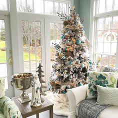 Benjamin Moore Catalina Blue. Wall paint color is Benjamin Moore Catalina Blue. When the Tree Decor Matches the Wall Color #BenjaminMooreCatalinaBlue Susan Lynn via Instagram @stylebysusanlynn.