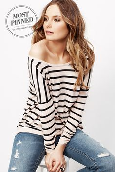 A slight borrowed-from-the-boys slouch adds an effortless sexiness to this sweater. l Off-the-shoulder Sweatshirt