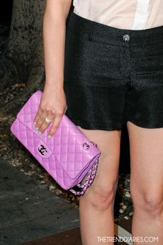 I'm dying for a pink Chanel purse like this...