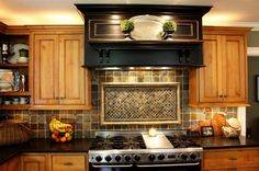Love the back splash tile and the center feature over the stove.