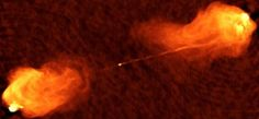 Researchers used the CanariCam telescope on the Canary Islands to peer at a supermassive black hole at the center of an elliptical galaxy called Cygnus A, which sits about 600 million light-years away. The black hole is actively sucking in material, and two powerful beams of light are shooting from the center of the galaxy all the way to the edge and beyond.