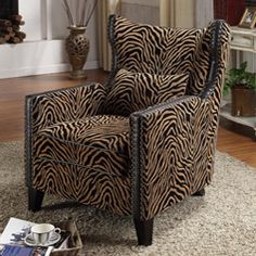 @Overstock.com.com - Tiger Chenille Nail Head Accent Chair - Add some animal magnetism to your space with this tiger chenille chair that features antiqued nail head details. This accent chair is upholstered in brown tiger-print fabric with bi-cast leather trim to make a sophisticated presentation in any room.  http://www.overstock.com/Home-Garden/Tiger-Chenille-Nail-Head-Accent-Chair/5323755/product.html?CID=214117 $719.99
