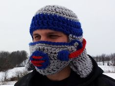 "GAS MASK HELMET - This gas mask helmet says, ""I'm prepared... for anything."" The mask detaches on one side using a clasp allowing you to sip your favorite beverage. Make one in your favorite team's colors. It's incredibly warm for those chilly games."