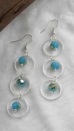 Sky Blue Crystal Triple Ring Dangle Earrings – Sky Blue Crystal and Silver  •Australian Handmade •Materials: Crystal beads, Brass base Silver findings  Length: 8 cm  My passion is making jewellery with these beads and findings and I would like to share my creative pieces with you.