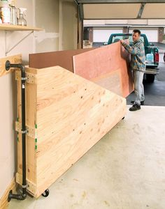 Swing-Out Plywood Storage | Popular Woodworking Magazine | Small Woodworking Shop Ideas |  Woodworking Shop Layout  | Garage Woodworking Shop Layout | Traditional Workbench Plans | Woodworking Shop Floor Plans. #woodfurniture #Shop