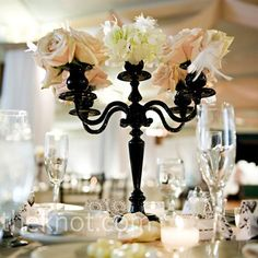 Black Candelabra Decor Small black candelabras with feathers, hydrangeas, and roses topped many of the tables. Candles and petals upped the romance. Black Candelabra, Candelabra Centerpiece, Wedding Centerpieces, Wedding Decorations, Vintage Centerpieces, Candelabra Flowers, Centerpiece Ideas, Flower Chandelier, Dream Wedding