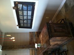door as a window, would be great for an outdoor bar. also reclaimed wood over ugly cinderblock walls