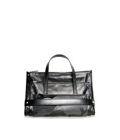 Leather Tote Bag, a result of the overlying of three different envelopes, attached to one another from the famous pyramid studs by @Valentino
