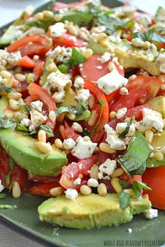 This simple tomato salad is loaded with lots of silky avocado, juicy tomatoes, crunchy nuts, and soft feta cheese. @WholeHeavenly