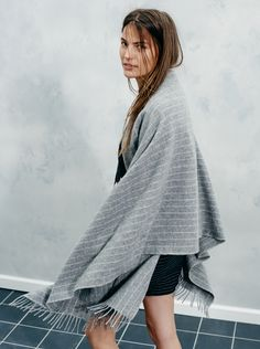 madewell cape scarf in pinstripe worn with the asymmetrical mini skirt.