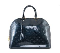 Authentic Louis Vuitton Vernis Alma MM bag. It is done in glossy Vernis patent leather with embossed monogram Louis Vuitton logo throughout the body of the bag accented by elegant golden hardware. It features a flat structured bottom and a roun - goalsBox™