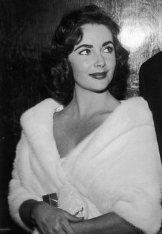 Elizabeth Taylor at a party for the opening of John Huston's film Moby Dick at the Mocambo nightclub, 1956