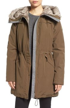 Free shipping and returns on Vince Camuto Parka With Faux Fur Lined Hood at Nordstrom.com. Insulate yourself against the harshest weather in this three-quarter length, rain-repelling parka topped with a cozy oversized funnel neck collar and convertible hood, both lined with soft faux fur. Storm flaps top the shoulders while toggle drawcords let you adjust the fit of the waist and dipped hem.