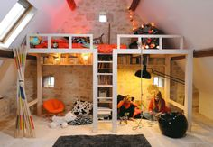 A loft bed maximizing storage space andit looks cool.In this beautiful attic kids' bedroom built a loft bed forextra play space.The staircase divides the space under the bed into 2...