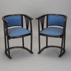"Pair Josef Hoffmann Armchairs with Blue Upholstery --- Circa 1910 pair of Josef Hoffmann armchairs have dark wood, nearly black stained frames with U-shaped curved base and backs, blue upholstery and slatted fan details at the sides.  Seats are 18"" high. We also have a coordinating settee / upholstered bench.  Please inquire. ---  Item: 4177 --- Retail Price:  $4895"