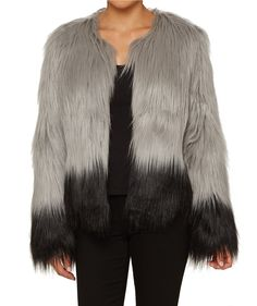 Add cool-girl vibes with the Faux Fur Jacket. This grey and black toned faux fur jacket features hook & eye front closure and is fully lined.