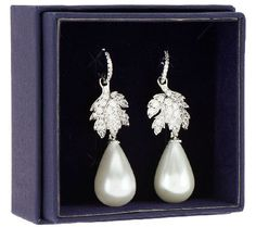 A classic replica. Inspired by the early 16th century La Peregrina pearl given to Elizabeth Taylor, these silvertone earrings are luminescent with a pear-shaped white simulated pearl. It dangles delicately from a leaf motif that's pave-set with clear, round simulated diamonds and a petite base bead-set with round simulated diamonds. From the Elizabeth Taylor Jewelry Collection. QVC.com