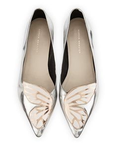 """Sophia Webster metallic leather flat with butterfly wing appliqu. 0.5"""" flat heel. Pointed toe. Tonal topstitching. Leather outsole. Slip-on style. """"Bibi Butterfly"""" is made in Brazil."""