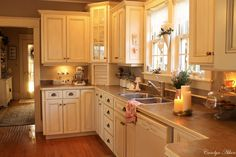looks like our kitchen layout (appliance garage and all!) - lovin' the idea of white cabinets...