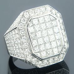 This luxurious 14K Gold Designer Diamond Ring with Large Diamonds weighs approximately 24 grams and showcases 11 full carats of dazzling invisibly set princess cut diamonds in the center and pave-set round diamonds on the sides. Featuring a magnificent design, a highly polished gold finish and large, top-quality genuine diamonds, this men's diamond designer ring is available in 14K white, yellow and rose gold.