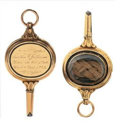 "Thomas Jeffersons Watch Key with a lock of his wife's hair and is inscribed ""Martha W. Jefferson"""