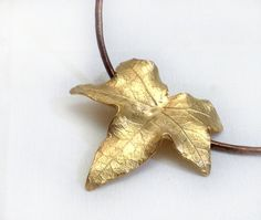 Ivy Leaf Pendant  Gold on Brass by mariastudio on Etsy, €46.57 https://www.etsy.com/treasury/MTI5OTQ4ODR8MjcyNDY5NTcxMg/i-see-you-pretty-thingshearts?ref=af_you_tre