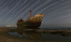 """Star trails and also a """"ghost"""" -- look to the left side of the ship Astronomy Pictures, Abandoned Ships, Abandoned Places, Star Trails, Ghost Pictures, Ghost Ship, Night Photography, Milky Way, Night Skies"""