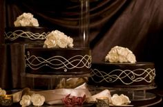 Beautiful dark chocolate wedding cakes. Could do the opposite with white cake chocolate accents