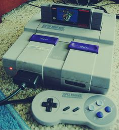 Super Nintendo With Super Mario World!!!!! I am still mad over the fact that my dad threw mine away :(