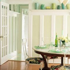 Rethink Classic Architectural Features: High wainscoting is a hallmark of an Arts-and-Crafts style home. A light paint color keeps the woodwork from feeling too heavy, and the coastal hue gives the room a beachy look.