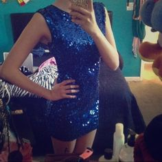 Blue sequin dress Adorable fit with beautiful cobalt blue sequins. Only worn once. Cute keyhole open back Forever 21 Dresses