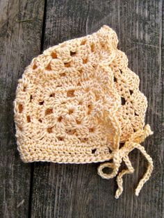 Crochet a Cute Baby Bonnet with Step-by-Step Instructions: This bonnet would be the perfect accessory for a Springtime baby.