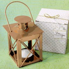 Love Lights The Way Luminous Lantern in a Matte Gold Finish- Your special occasion symbolizes a new path in your life. Light it up with beautiful golden lanterns and share the Light of Love with friends and family. Our lantern is crafted from metal w Gold Lanterns, Gold Candles, Wedding Lanterns, Metal Lanterns, Candle Lanterns, Candle Wedding Favors, Bridal Shower Centerpieces, Bridal Shower Favors, Party Favors
