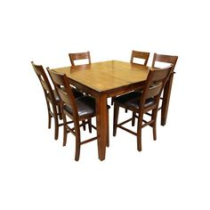 The Emilie 7 Piece Counter Height Set from Holland House lets you to dine in comfort and style with family or friends. Solid mango wood and veneers. Black faux leather upholstery on