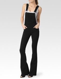 Tavie Flare Overall - Raven Black - PAIGE  The Tavie is inspired by our beloved Lou Lou Flare. This midrise overall hugs the hips and begins to flare right below the knee. It is featured in a structured, but comfortable, black stretch fabric that has been washed down to a perfect vintage shade.