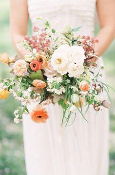 Wedding bouquet, love the wildflower look orange