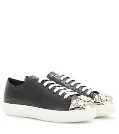 Miu Miu - Embellished patent leather sneakers - Add glitz and glam to your casual ensembles with a pair of Miu Miu sneakers. The modern design is sprinkled with crystal embellishment adorning a silver-tone toecap. Highlight the shimmering patent leather by wearing them with bare legs, styling with a floaty dress and sporty bomber jacket. seen @ www.mytheresa.com