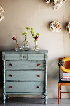 This dresser is unique and colourful. I love the details and the rustic feel! :) It is an appropriate size for my room, and will be very functional. However it is also very visually interesting, and pulls from the colours of my curtains and headboard.