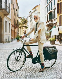 Cool Bike, Great suit, amazing beard. Hero.